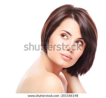 Beautiful Girl Touching Her Face. Isolated on a White Background. Perfect Skin. Beauty Face. Professional Makeup