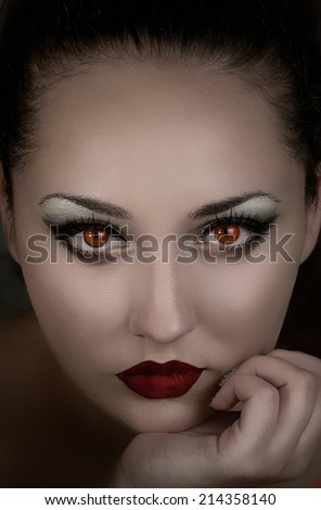 Beautiful girl vampire. Demon, witch. Mysterious woman. Fantasy book cover - stock photo