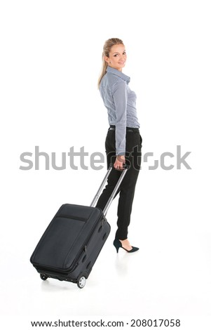 beautiful girl walking with luggage and smiling. back view of young girl on white background - stock photo