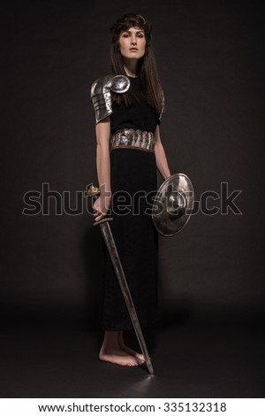 Beautiful Girl warrior in medieval clothes