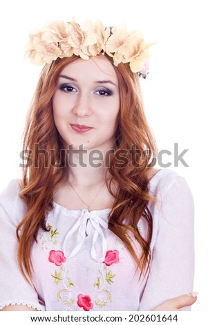 Beautiful girl wearing a crown of flowers on a white background - stock photo