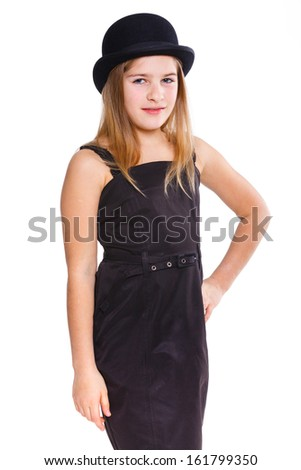 Beautiful girl wearing black dress and bowler hat in studio. Isolated on white backround.