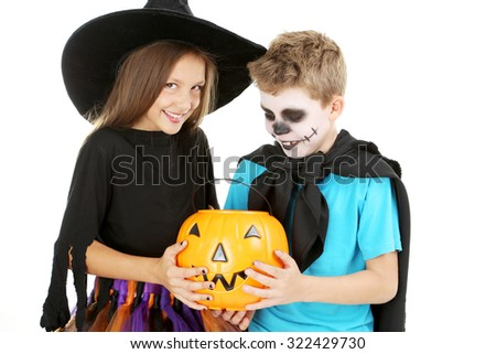 Beautiful girl witch and little boy with basket for candies on a white background