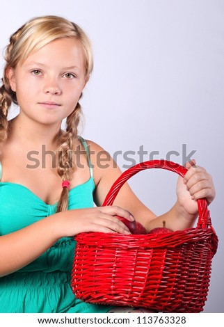 Beautiful girl with a basket of   Apples