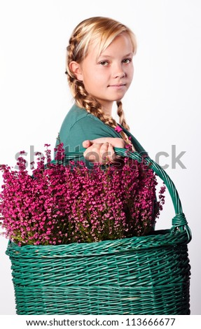 Beautiful girl with a basket of Purple heather flowers