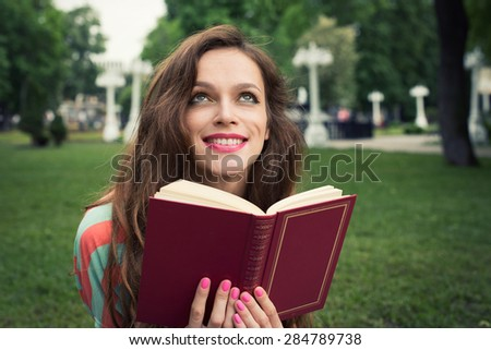 beautiful Girl with a book in the park