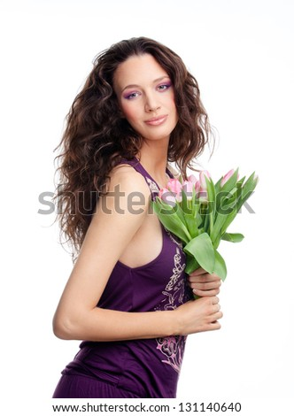 Beautiful girl with a bouquet of tulip flowers