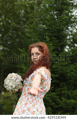 beautiful girl with a bouquet of wildflowers