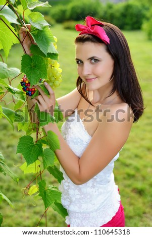 Beautiful girl  with a bunch of grapes