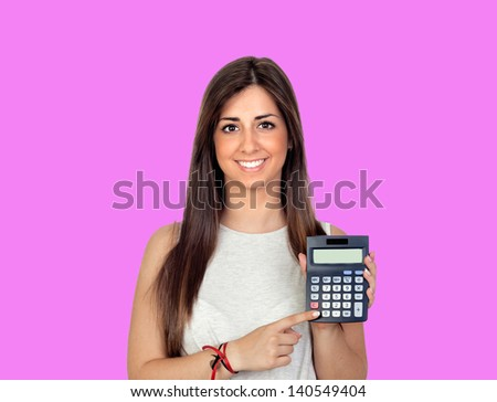 Beautiful girl with a calculator on a pink background - stock photo