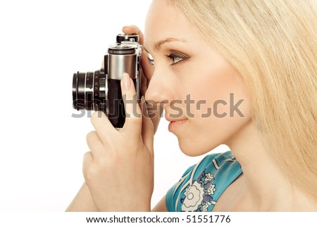 beautiful girl with a camera taking a photo - stock photo