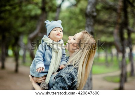 Beautiful girl with a Chinese baby are happy in park