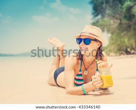 beautiful girl with a cocktail on the beach. Traveling, beach vacation, tropical countries
