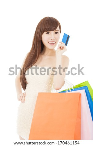 beautiful girl with a credit card and shopping bags isolated