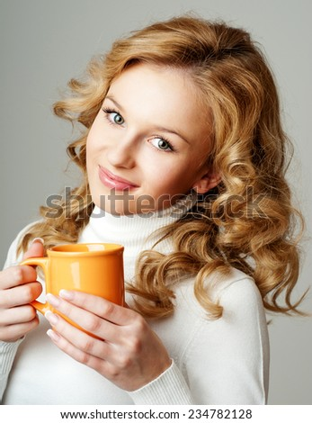 beautiful girl with a cup of tea. the winter season. - stock photo