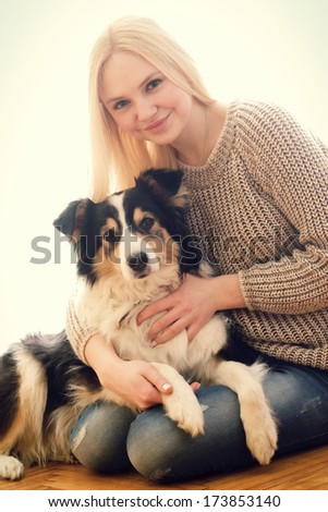 beautiful girl with a fluffy dog