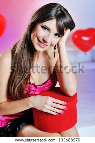 Beautiful girl with a gift in her hands - stock photo