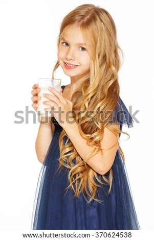 Beautiful girl with a glass of milk - stock photo