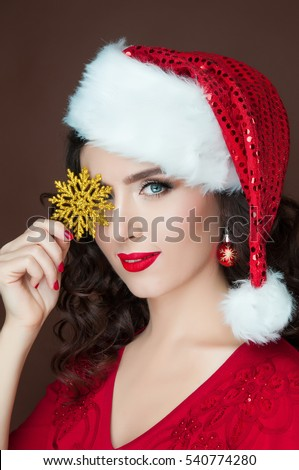 Beautiful girl with a golden snowflake, studio close-up portraits, New Year, Christmas