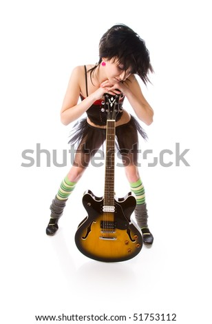 Beautiful girl with a guitar on a black background - stock photo