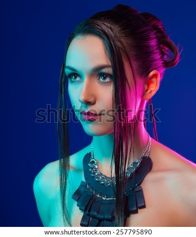 beautiful girl with a hairdress. studio shot on blue background - stock photo