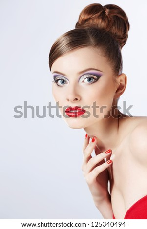 Beautiful girl with a hairstyle and make-up - stock photo