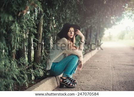beautiful girl with a hat in summer park - stock photo