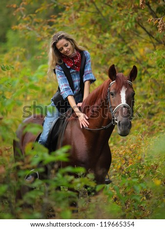 Beautiful girl with a horse in countryside