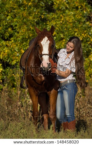 Beautiful girl with a horse  in countryside.