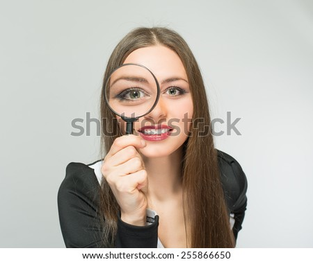 beautiful girl with a magnifying glass - stock photo