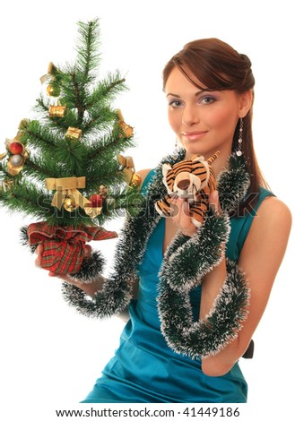 Beautiful girl with a new-year tree and tiger cub. On an east calendar New 2010 Year - year of tiger. - stock photo