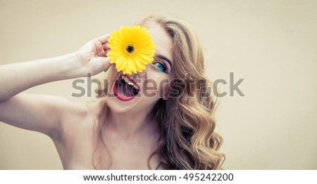 Beautiful girl with a nice flower in hand