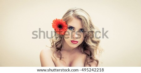 Beautiful girl with a nice flower on the face