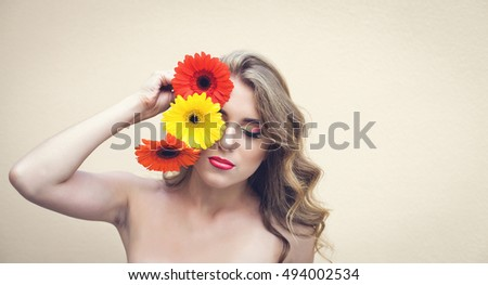 Beautiful girl with a nice flowers in hand