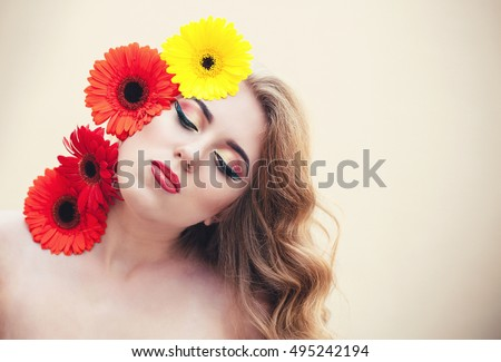 Beautiful girl with a nice flowers on the face