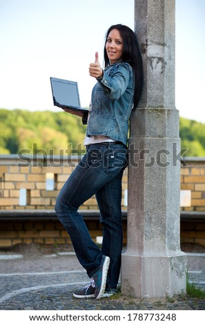Beautiful girl with a notebook in her hand