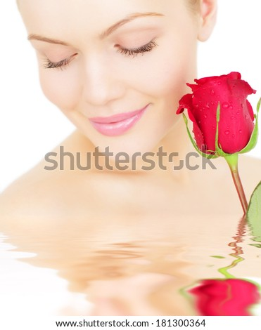 Beautiful girl with a red rose on white background - stock photo