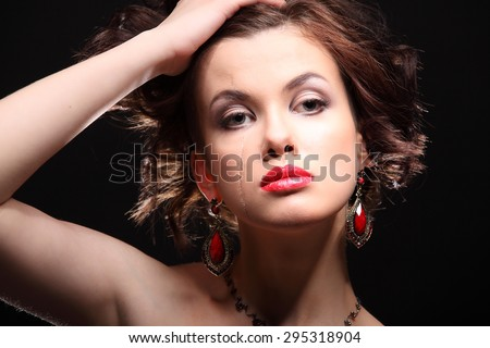 beautiful girl with a scar on face and shoulder studio