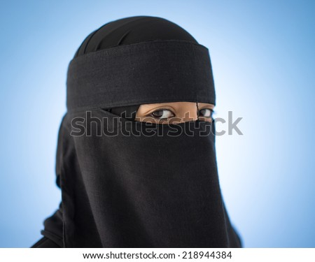 Beautiful girl with a scarf and black veil - stock photo