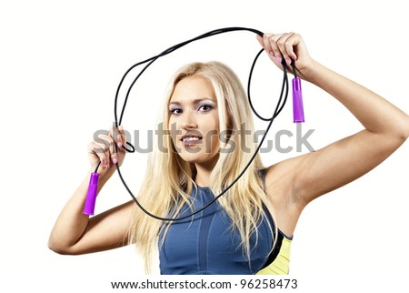 beautiful girl with a skipping rope - stock photo