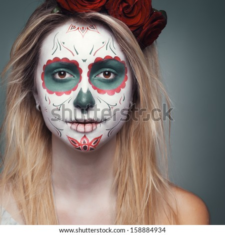 beautiful girl with a skull face makeup - stock photo