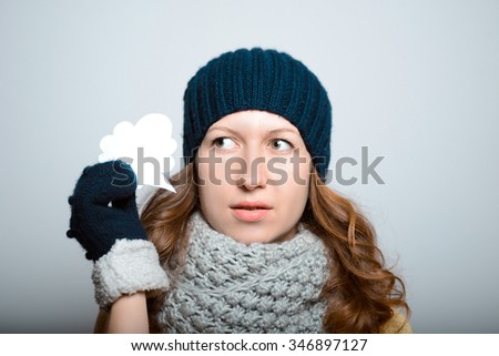 beautiful girl with a sticker have an idea, lifestyle winter clothes studio photo isolated on a gray background