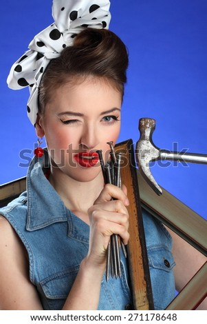 beautiful girl with a tool . stylish hair and stylish make-up. bright emotions .pin-up girl  - stock photo