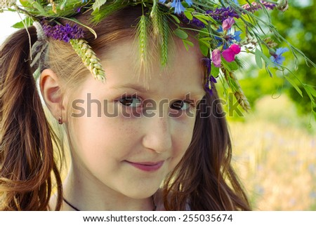 beautiful girl with a wreath of flowers on her head  - stock photo