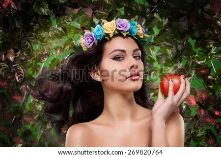 beautiful girl with a wreath on his head with apple   - stock photo