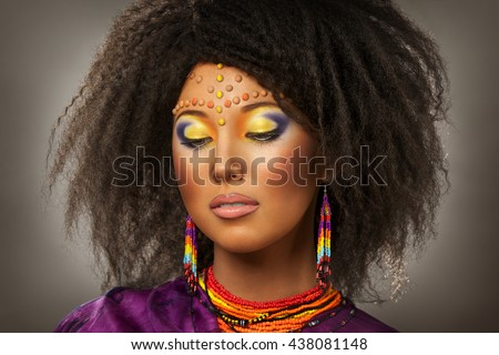 beautiful girl with African roots on a grey background - stock photo