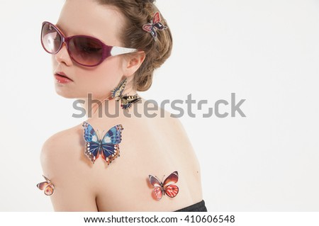 Beautiful Girl With and Butterfly. Beauty Face - stock photo