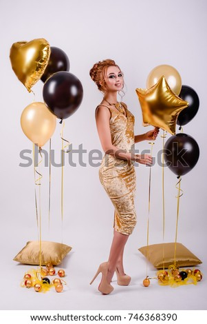 beautiful girl with balloons in the studio, celebrating the new year