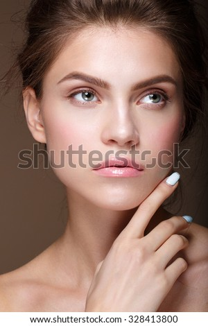 Beautiful girl with beautiful makeup, youth and skin care concept, photoset of attractive brunette girl with hand near face - stock photo