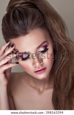 Beautiful girl with beautiful makeup, youth and skin care concept / photoset of attractive brunette girl on beige background - stock photo